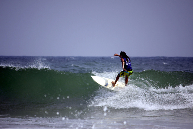 Surfing in Kovalam Beach